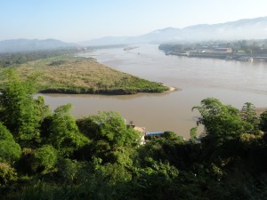 Standing in Thailand with Myanmar to left, China over the mountains and Lao on right bank of Mekong.