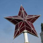 Red star that previously stood atop communist party headquarters